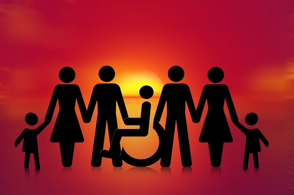 Image of families with wheelchair users at sunset
