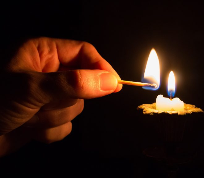 Image of candle being lit with a match